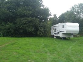 American slide out caravan available near Bath in private field with fishing. - Image #2