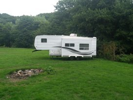 American slide out caravan available near Bath in private field with fishing. - Image #3