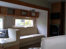 American slide out caravan available near Bath in private field with fishing. - Image #5