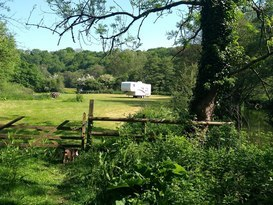 American slide out caravan available near Bath in private field with fishing. - Image #1